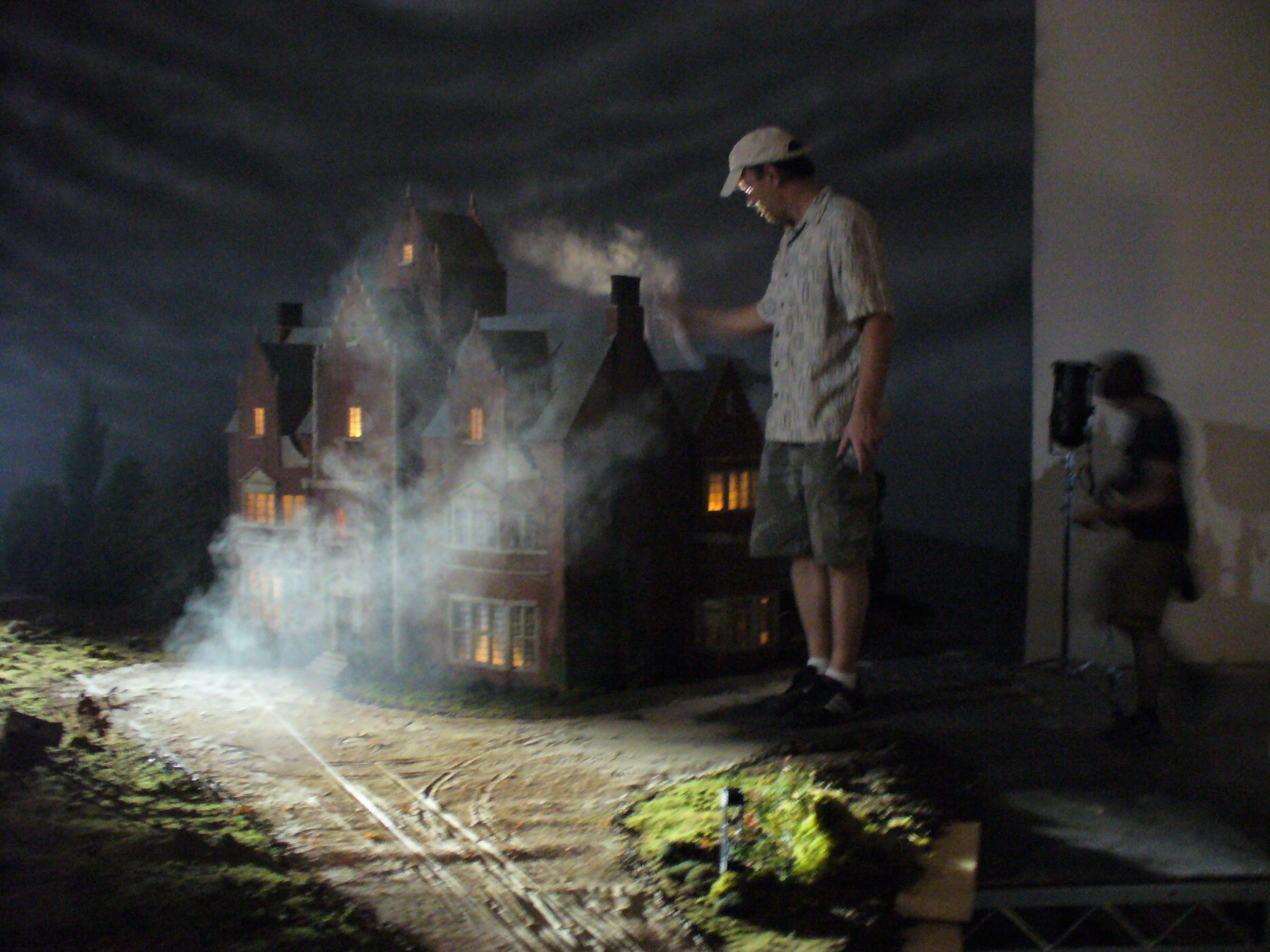Production designer Anton Tremblay with his  old dark house model for Dark and Stormy Night